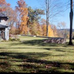 Lakeville – classic granite clad retaining wall with heavy blue stone cap frames long view