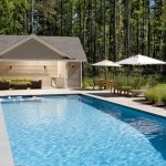 GB – 18′ x 50′ pool with spa, key operated cover, granite coping, stamped concrete terrace, pool house with shaded sitting area, outdoor wet bar, changing room, bathroom, indoor storage