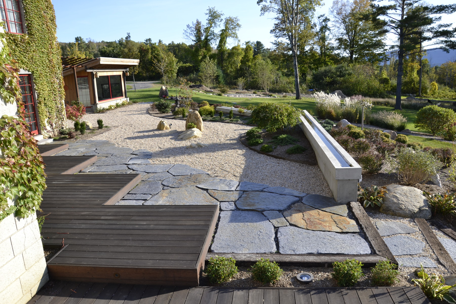 Berkshire Asian water weir, scalene triangulated water boulders, Goshen Stone terrace, Teak deck, 'Dwarf Woodlands'